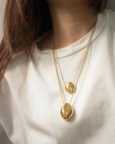 Layer on statement sculptural pendants for maximum impact - Gaia and Pebble Necklace by The Hexad
