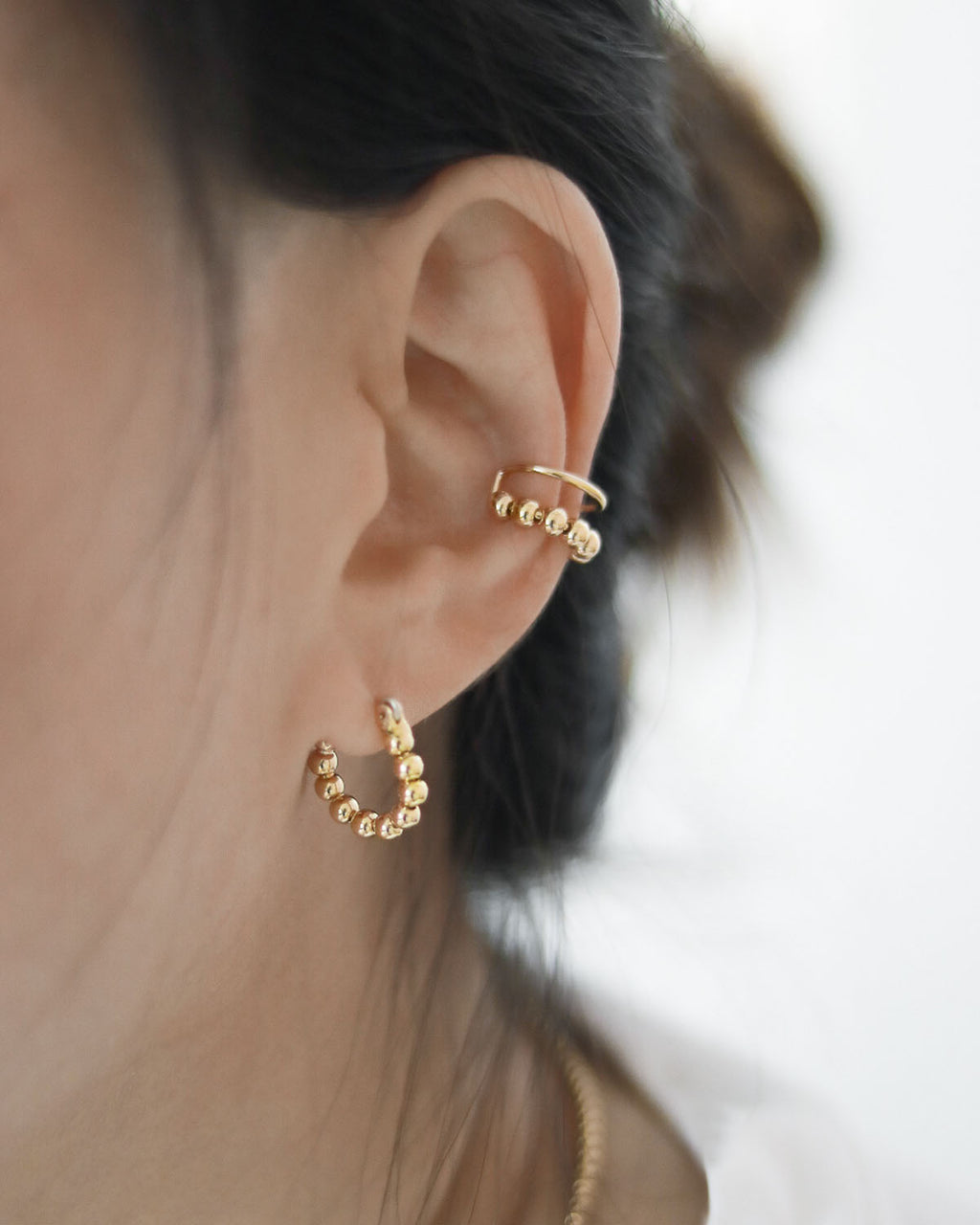 Layer the beaded hoop earrings with the beaded ear cuffs for a layered look @thehexad