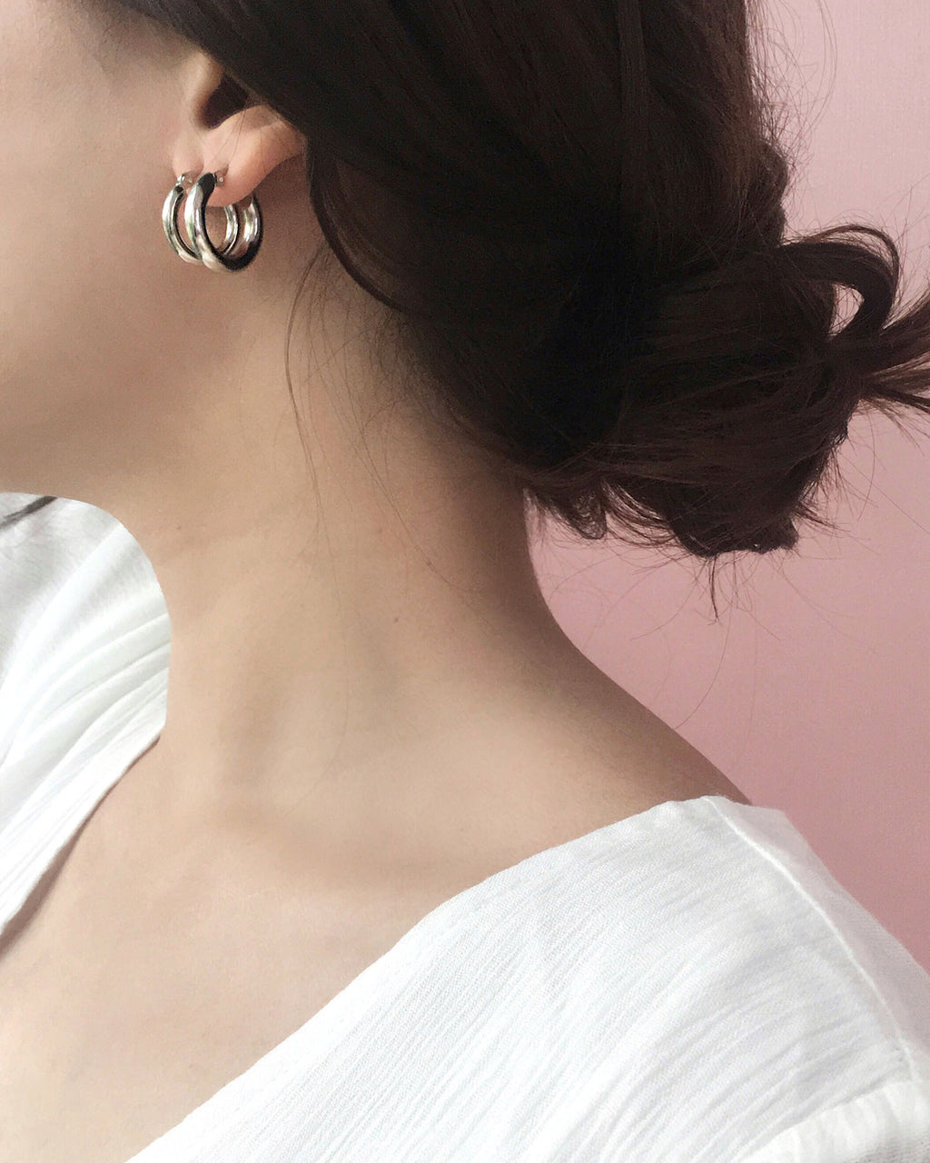 Layering the bold petite and bold medium Rei hoops in Silver - The Hexad Jewelry