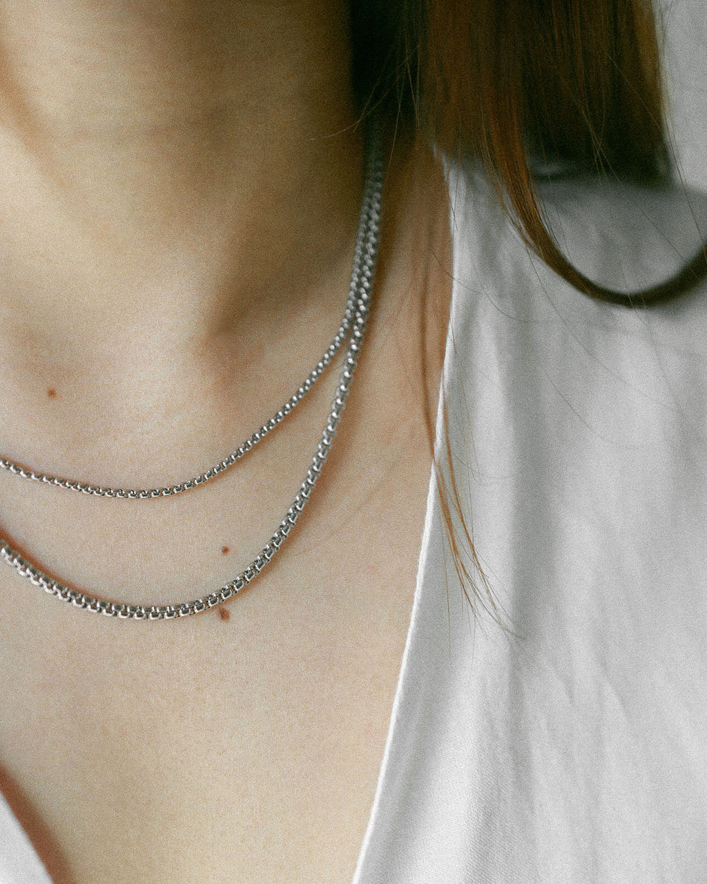 Layered box cut chains in silver from The Hexad's Necklace Collection