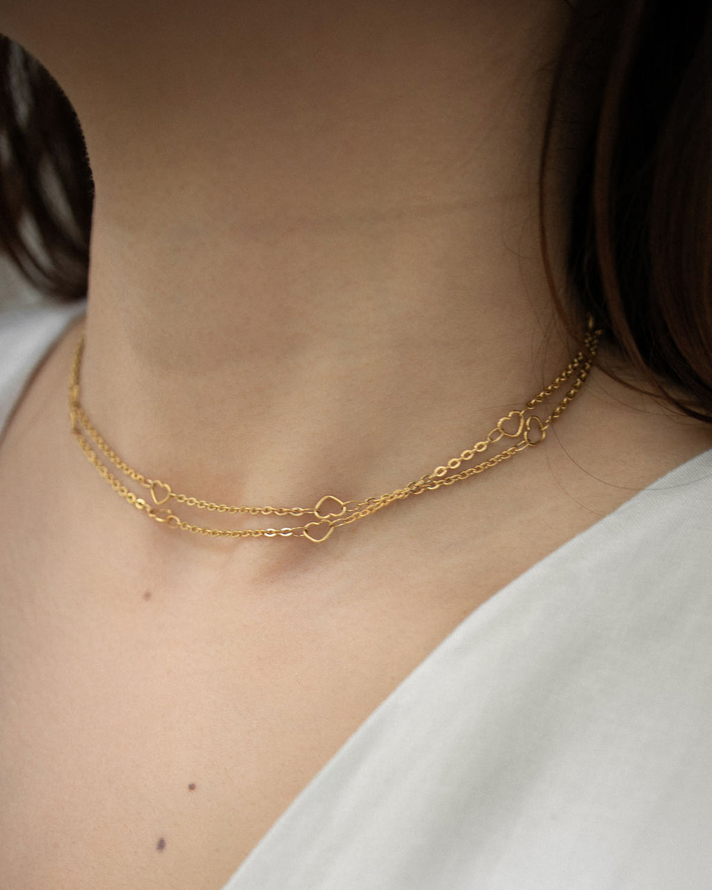 Long gold chain looped twice as a chic choker - Adore chain by The Hexad