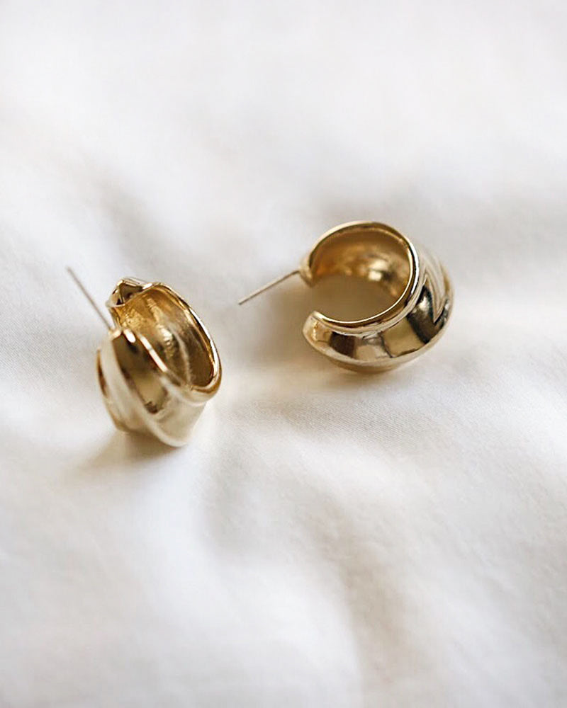 Loving these chunky gold hoop earrings that channel a vintage vibe - The Hexad Jewelry