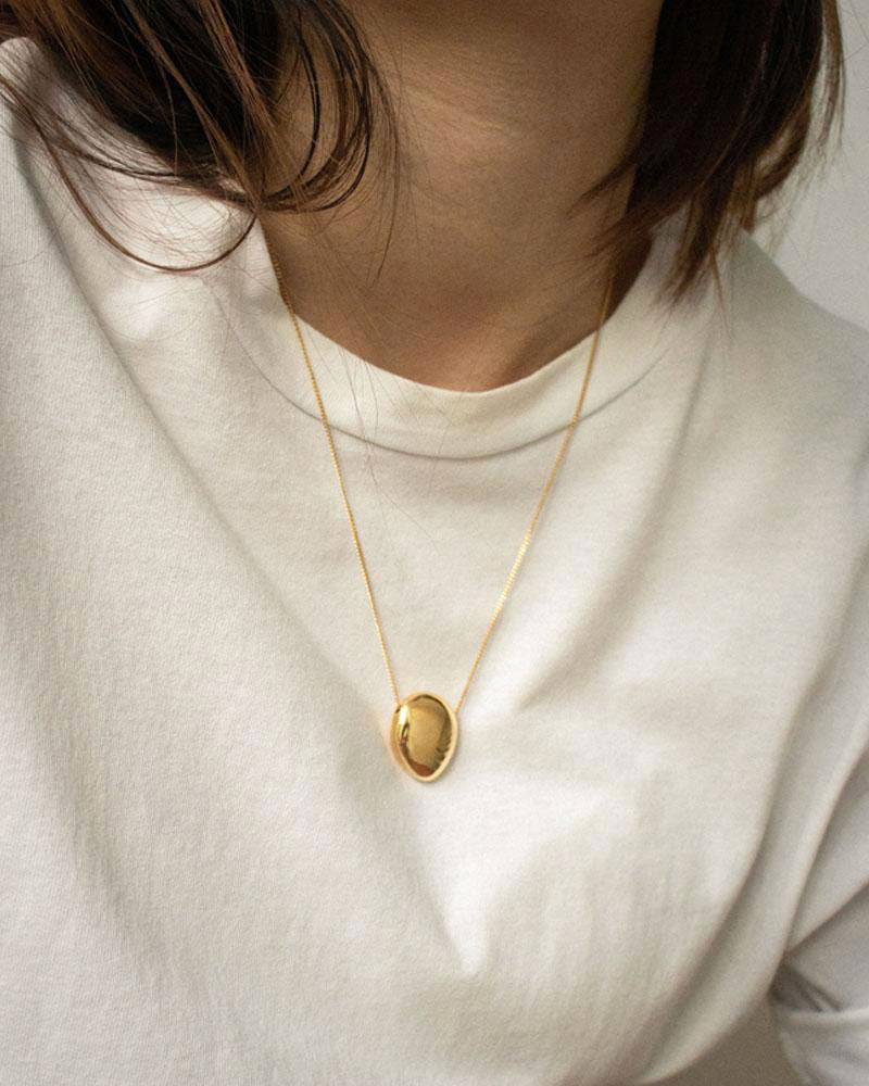 Minimalist pebble pendant necklace with thin delicate gold chain | The Hexad Jewelry