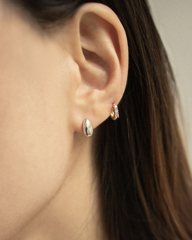 Minimalist silver ear studs in a teardrop shape - THE HEXAD