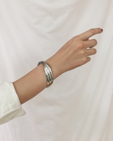 Minimalist twisted silver cuff bangle by THE HEXAD