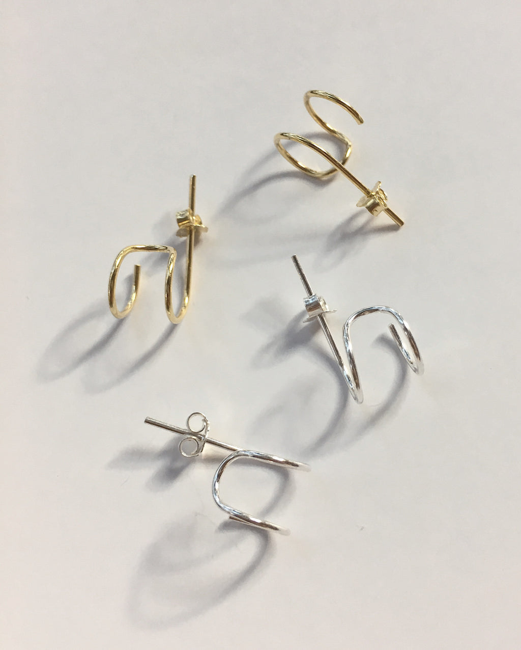 Minimalistic stacking hoop earrings - get the double hoop look with the Filament earrings - The Hexad