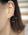 Model layers on pierceless ear cuffs without multiple piercings - The Hexad
