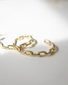 Modern golden hoop earrings for women designed by The Hexad