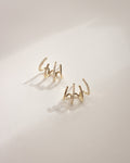 Modern illusion hoop earrings in gold by the hexad