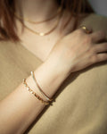 Parallel and Script chain bracelets by The Hexad Jewelry