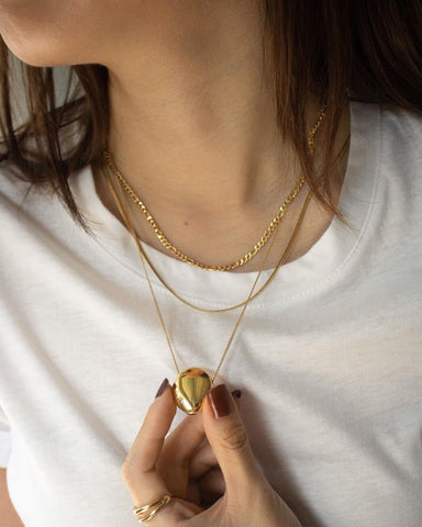 Pebble pendant, ellipses chain and reptile necklace by The Hexad