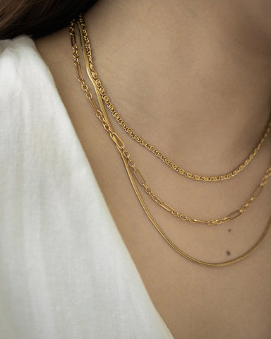 Perfect necklace stack with gold chains of varying lengths and textures - The Hexad