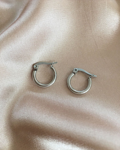 Petite silver hoops in 15mm diameter that is great for layering - The Hexad Jewelry