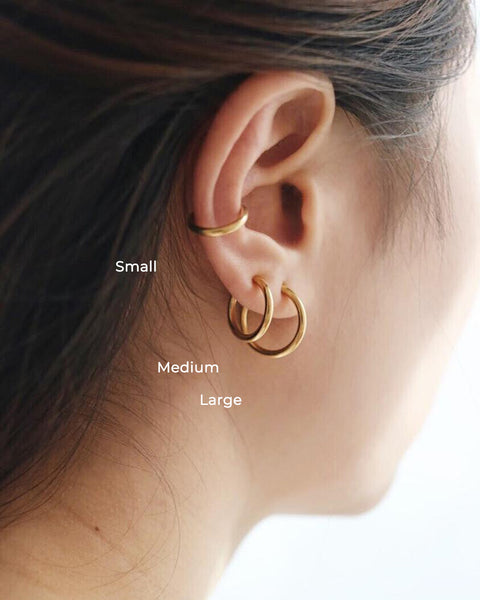 Retractable hoops worn on the ear lobes and as a ear cuff - The Hexad
