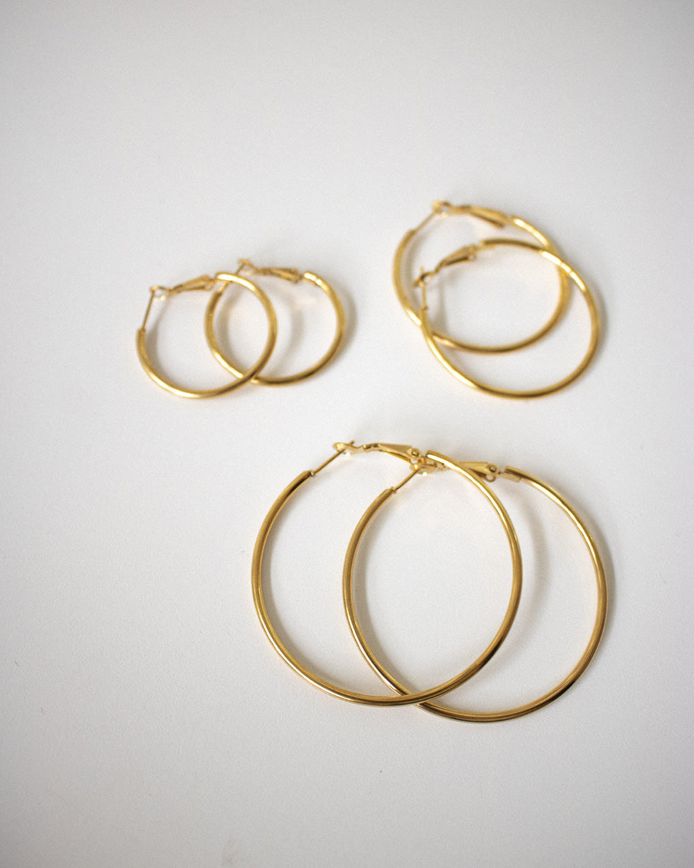 Saki Hoop Earrings in Gold by The Hexad