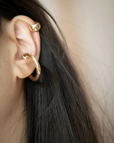 Saturn and Cocoon ear cuffs by The Hexad
