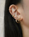 Serpent suspender earrings paired with huggies and ear cuffs - The Hexad