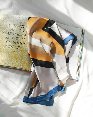 Silky scarf with geometric block pattern print in gold, navy black and light purple - The Hexad