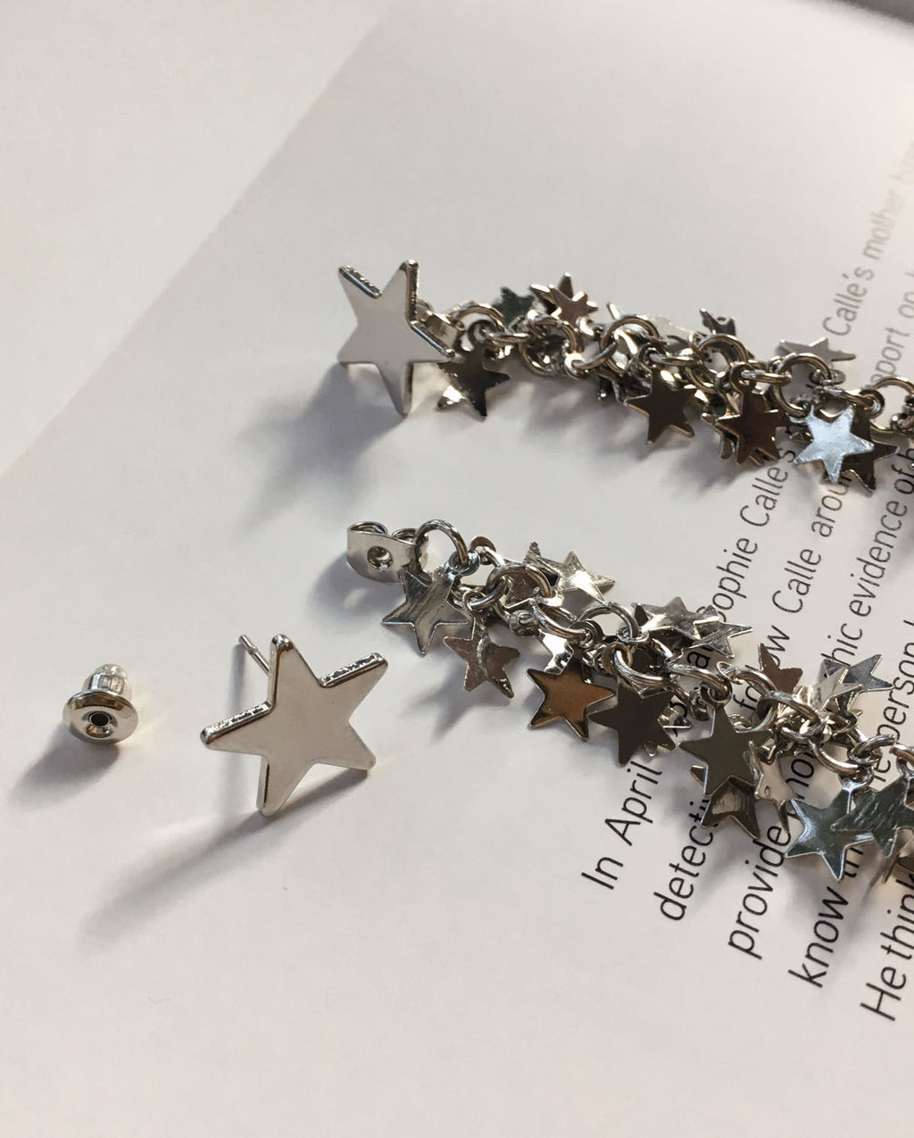 Silver star stud earrings with a matching dangling cluster of stars - TheHexad
