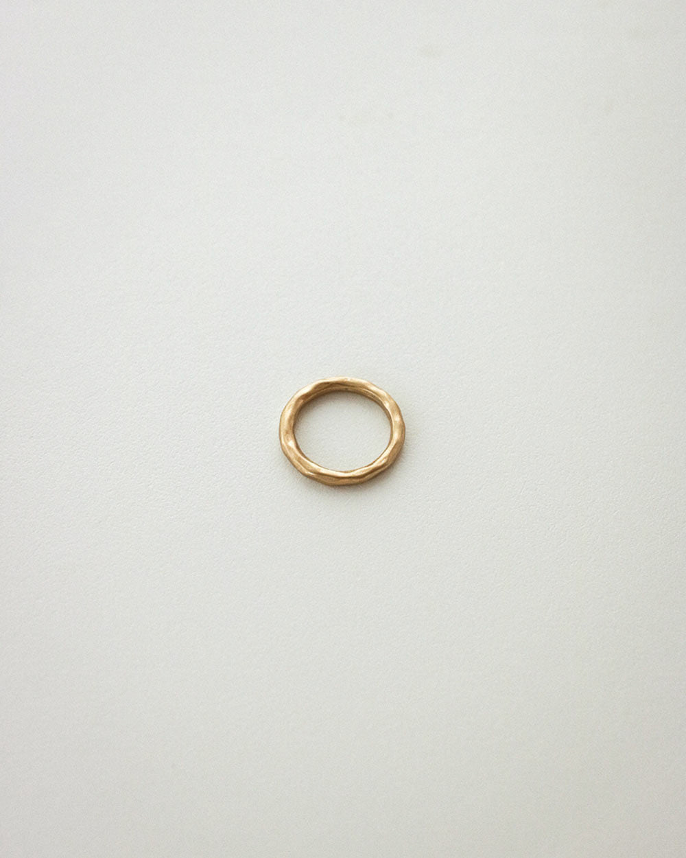 Simple, brushed finished ring in gold by The Hexad