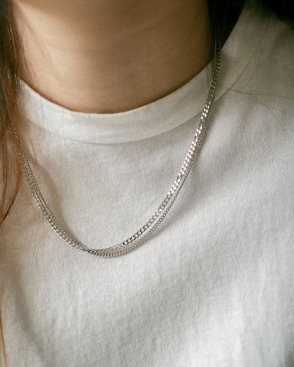 Simple silver chain necklaces in varying thickness for layering together - The Hexad