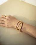 Simple stacking bracelets in gold - The Hexad Jewellery