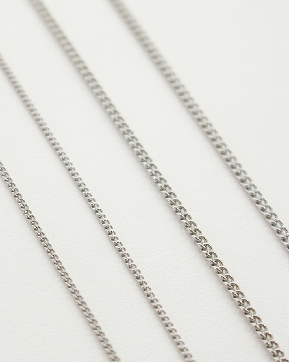 Simple thin silver chains perfect for layering - The Hexad