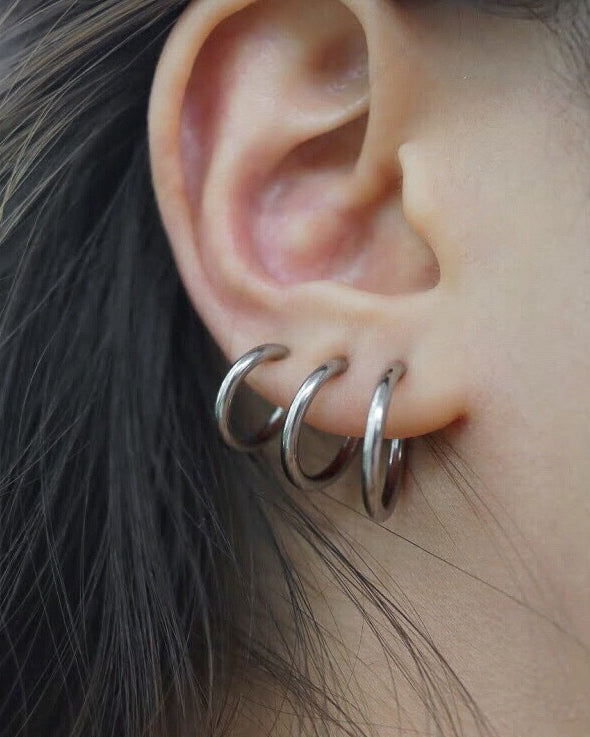Siver hoop earrings suitable for those with no piercings - The Hexad
