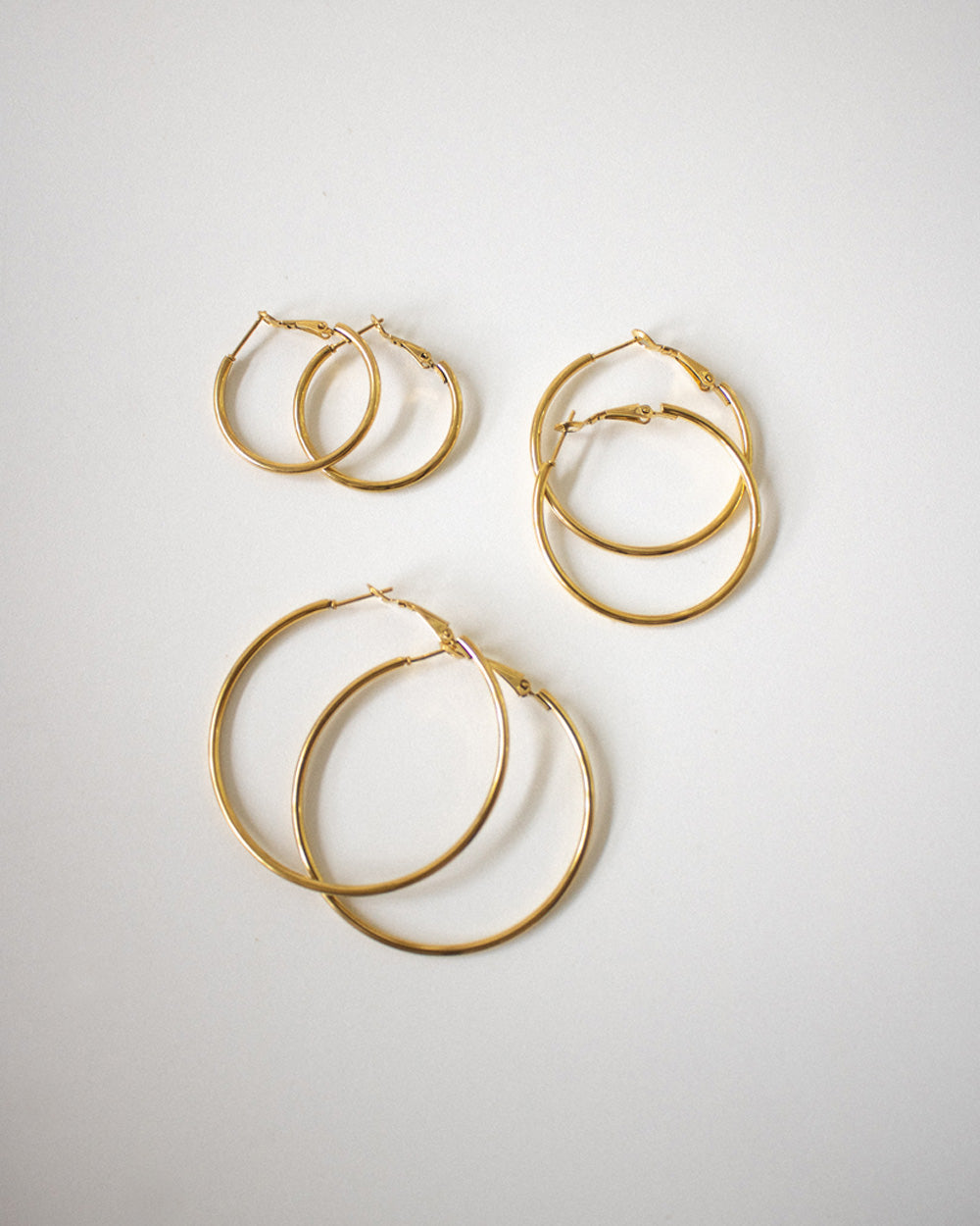 Skinny Saki Gold Hoops in 30mm, 40mm and 50mm diameter - The Hexad Earrings