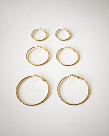 Sleek gold hoop earrings for everyday wear | The Hexad Jewelry