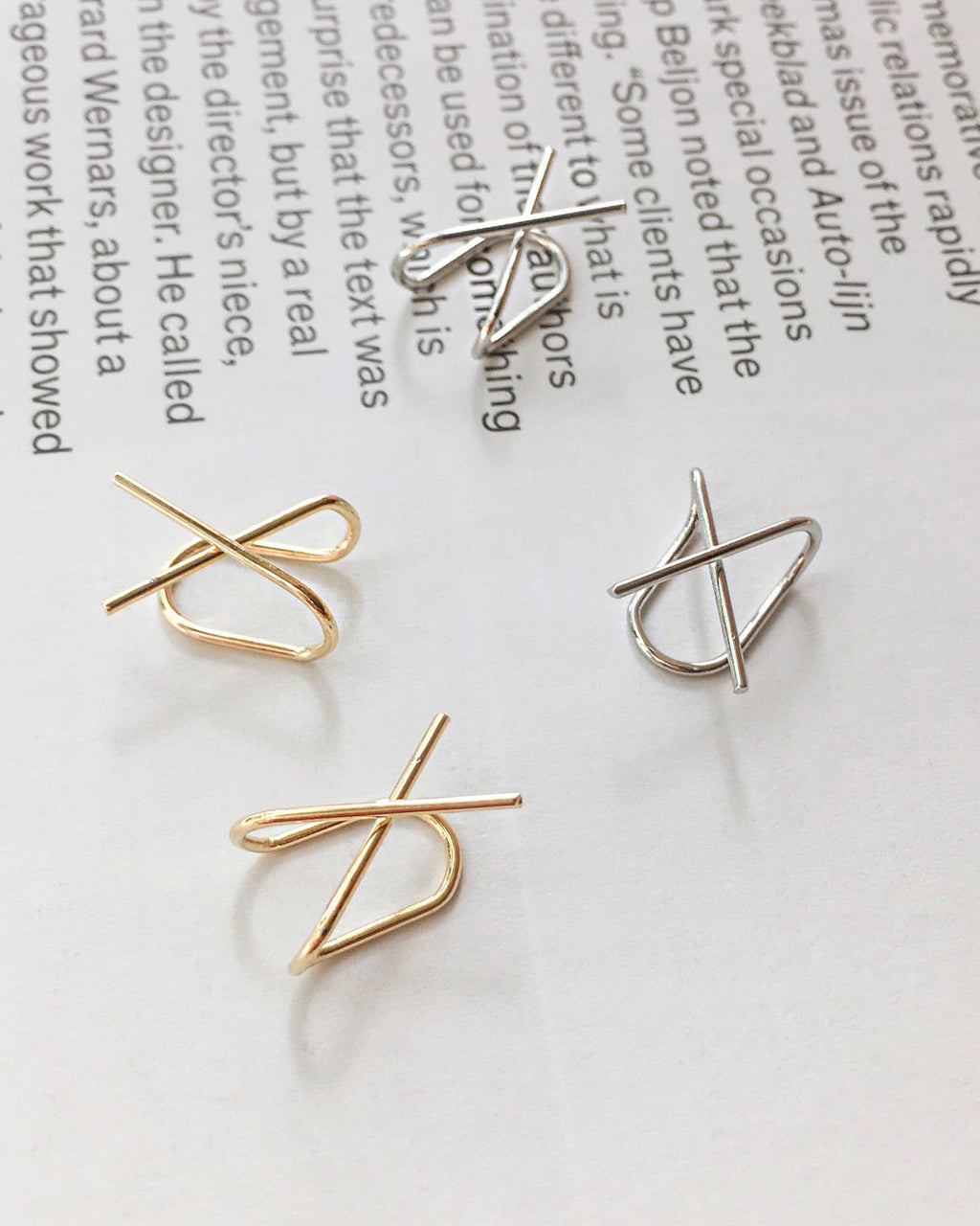 X-shape cross ear cuffs in gold and silver by The Hexad