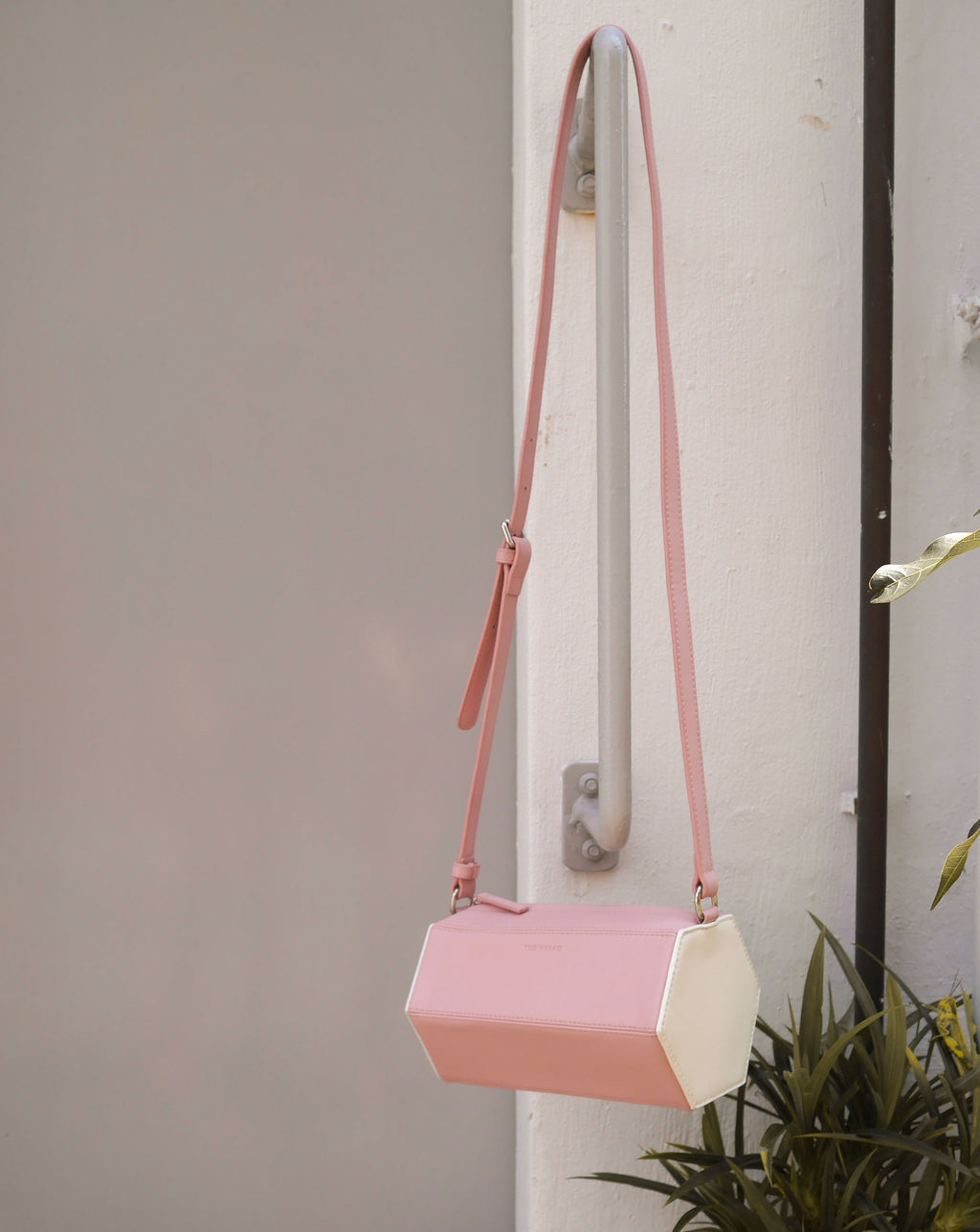 Small crossbody bag featuring a unique hexagon prism shape - fun and quirky styled bag - pink and white colors - The Hexad