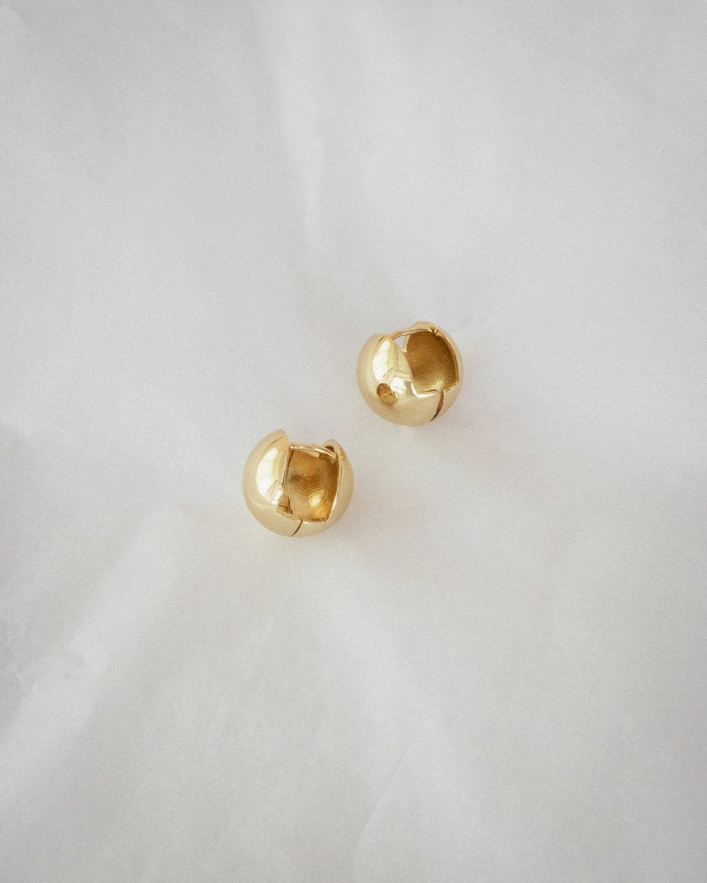 Spherical ball shaped earrings by The Hexad