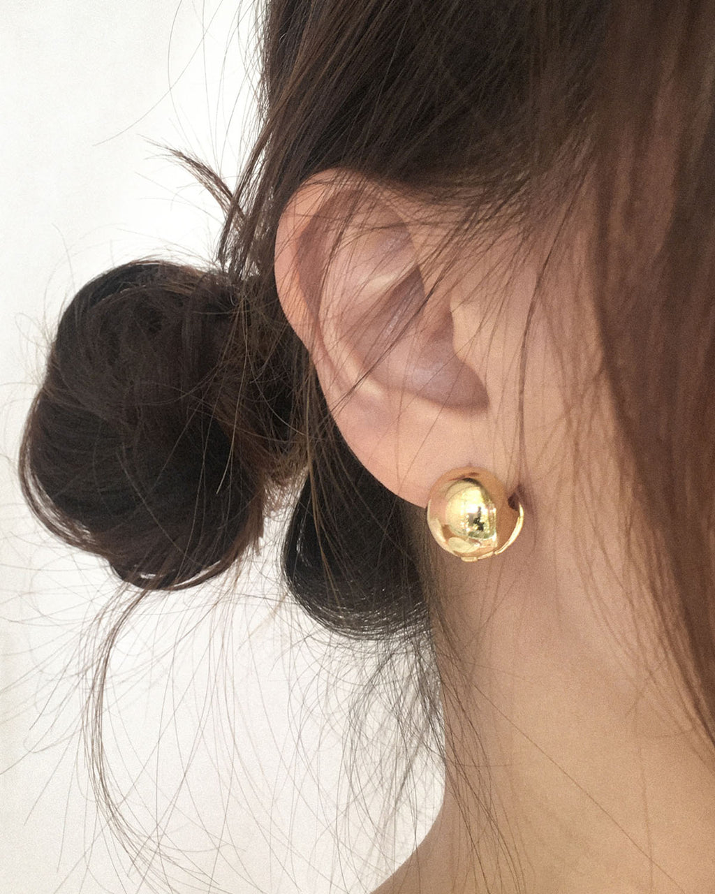 Spherical shaped earrings that hugs around your ear lobes - the CORA ball earrings | The Hexad Jewelry