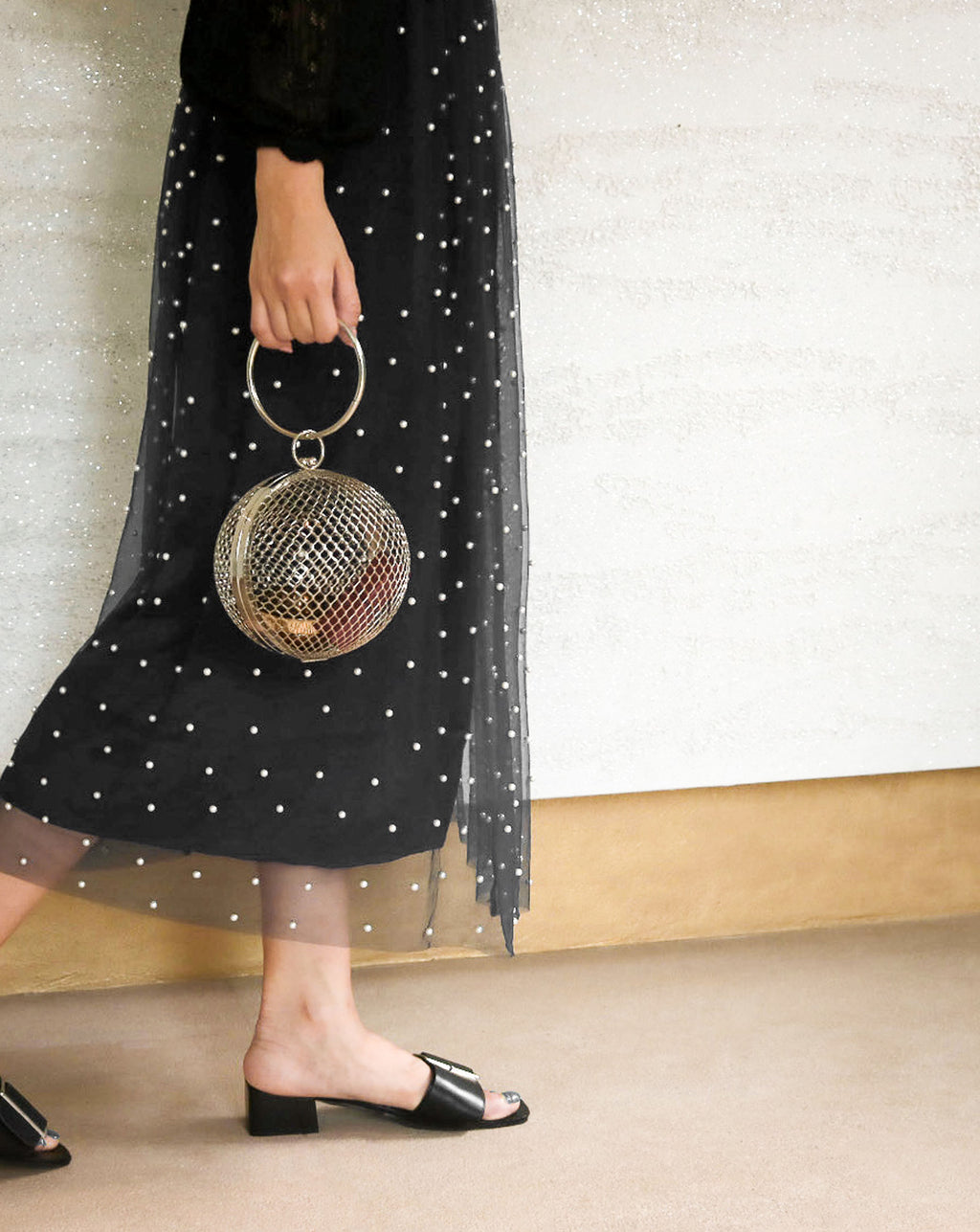 Stylish and unique cage ball clutch bag perfect for parties and events - The Hexad