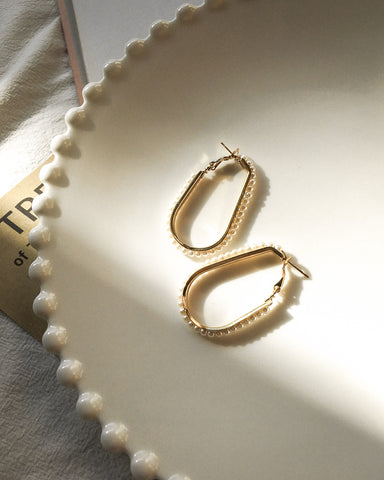 Stylish golden earrings featuring glossy faux pearls - Oval You Hoops by The Hexad Jewelry