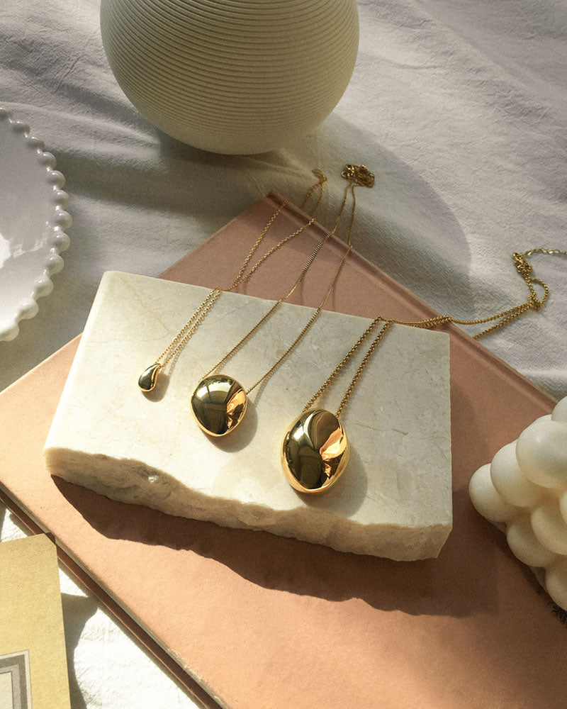 The Hexad's Teardrop, Pebble and Gaia Necklace in Gold