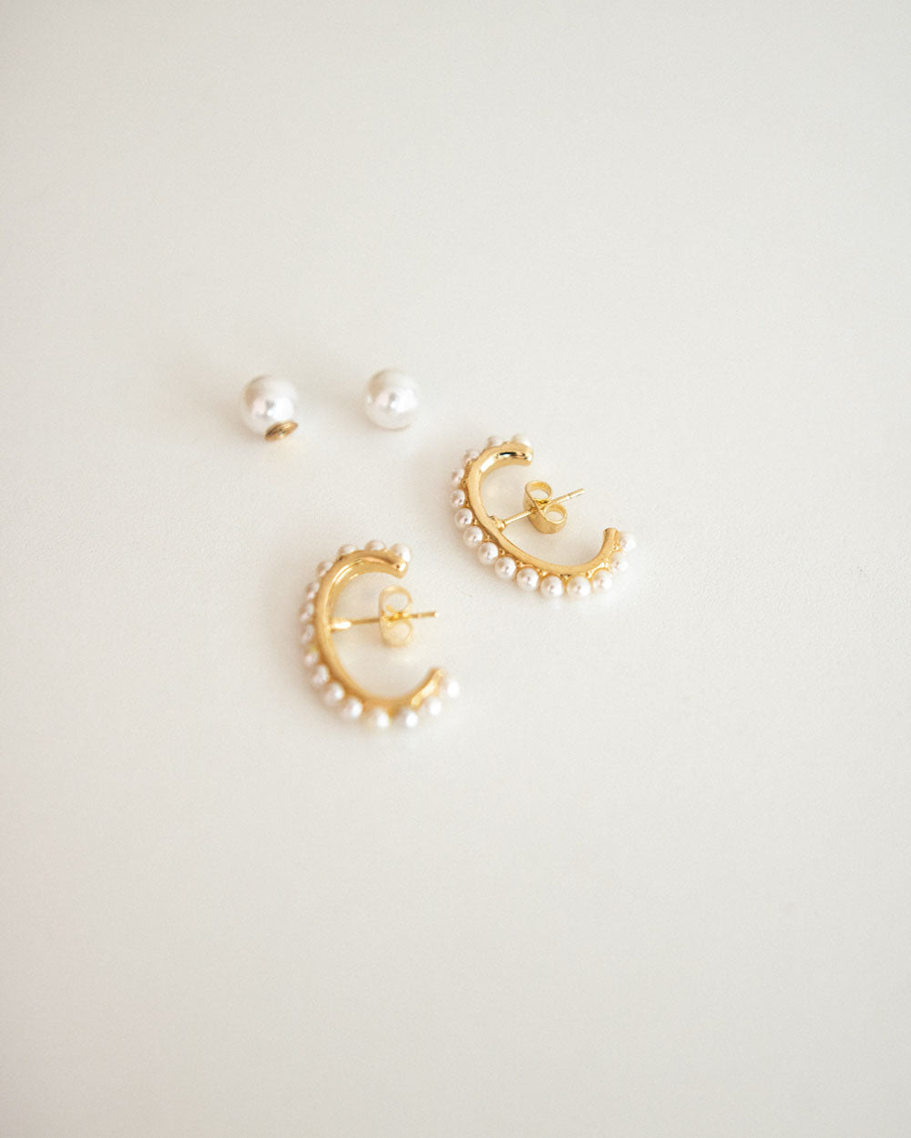 The Hexad's Yvette Suspender Ear studs with faux pearls