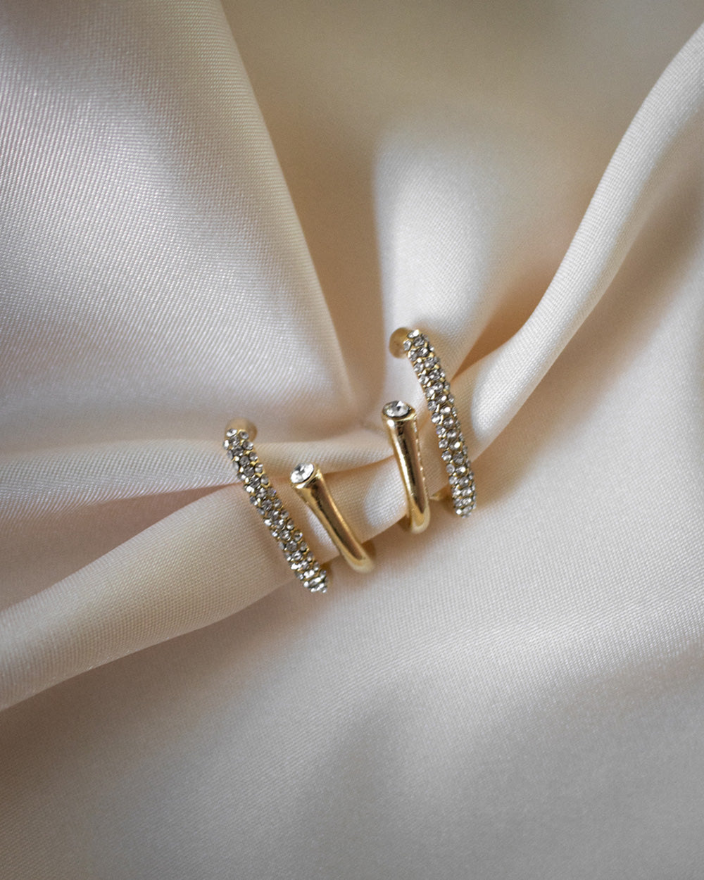 The duet suspender earrings features two gold bars embedded with shiny cubic zirconia stones - The Hexad Jewelry