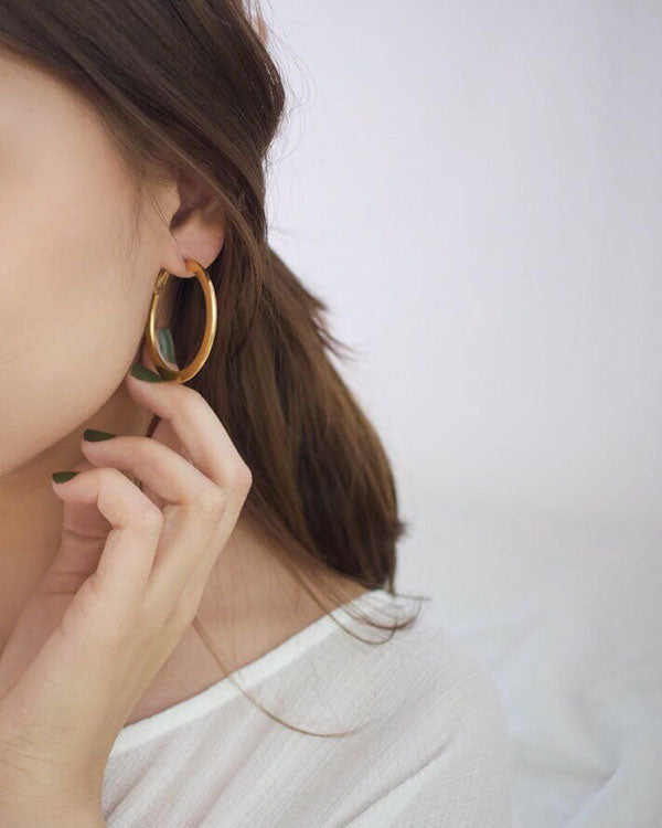Thin and flat gold hoops - The Hexad Jewelry