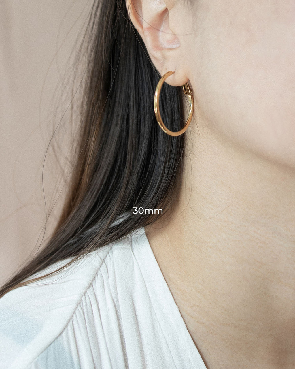 Thin, barely there gold hoop earrings in 30mm diameter | The Hexad