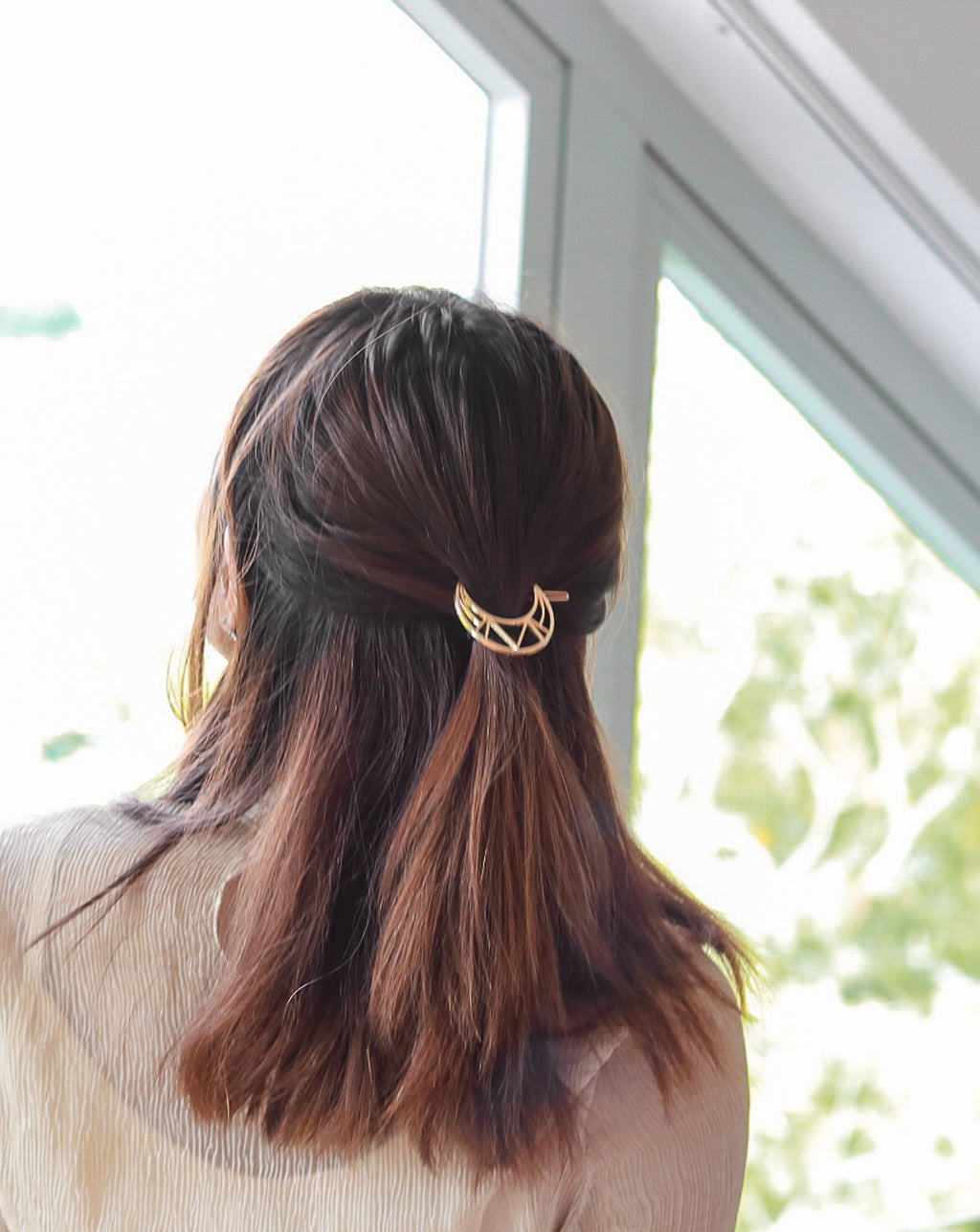 This aztec crescent moon clip adds a touch of elegance to a chic ponytail or half-up hairdo - The Hexad