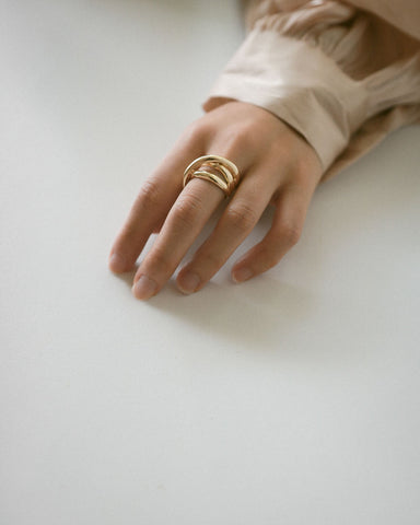 This unique statement gold ring with interesting layers will add depth to your ring look - The Hexad