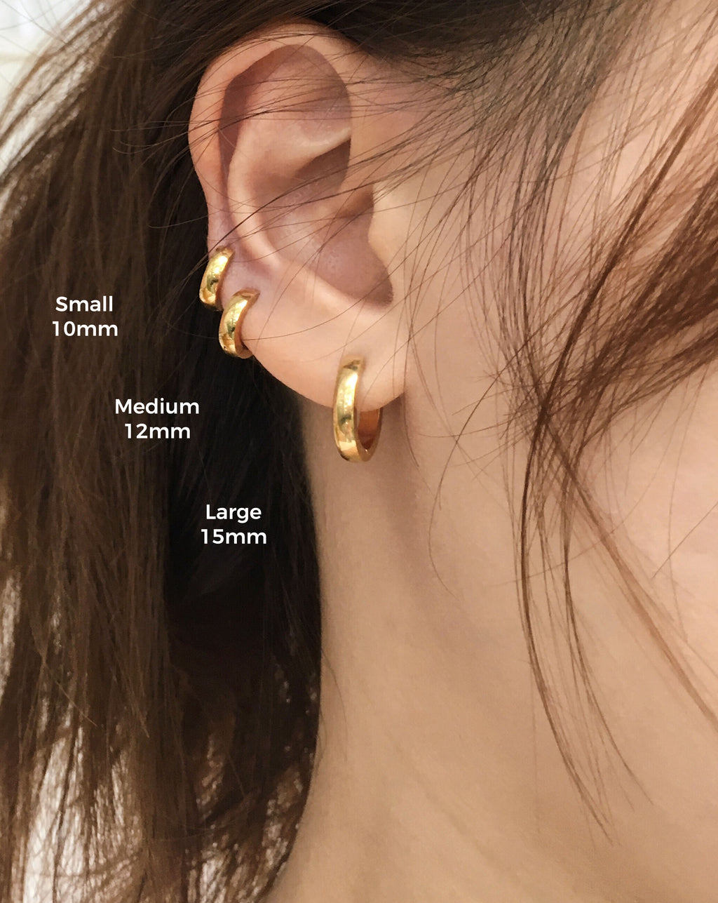 cc0618ae5 Tiny bold gold hoops perfect for multiple ear piercings - The Hexad.jpg.  Classic baby size endless hoops - Ise huggie earrings ...
