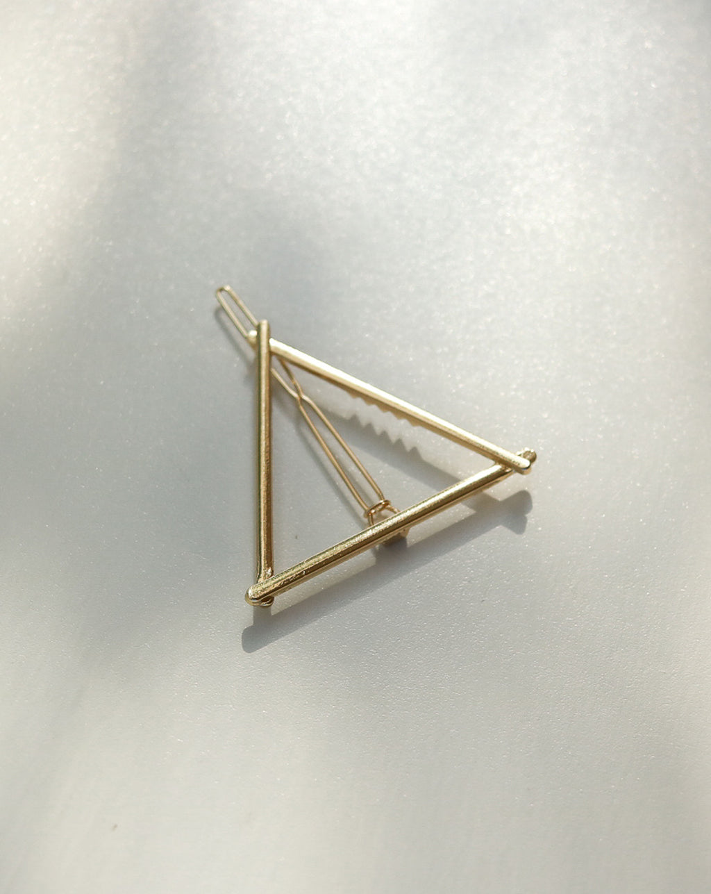 Triangle minimalist hair clip for an effortlessly elegant hairdo - The Hexad