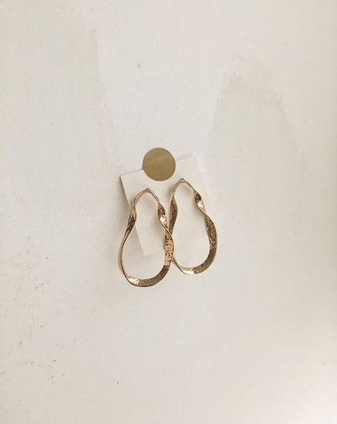 Twisted large hoop earrings worn as a stud - The Hexad Jewelry
