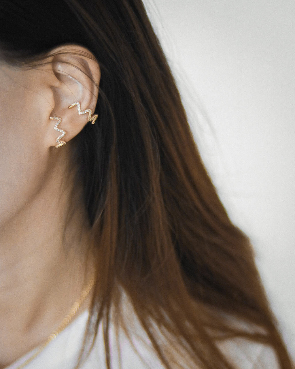 Unique suspender earrings are designed to appear they wrap around your lobes - The Hexad Jewelry