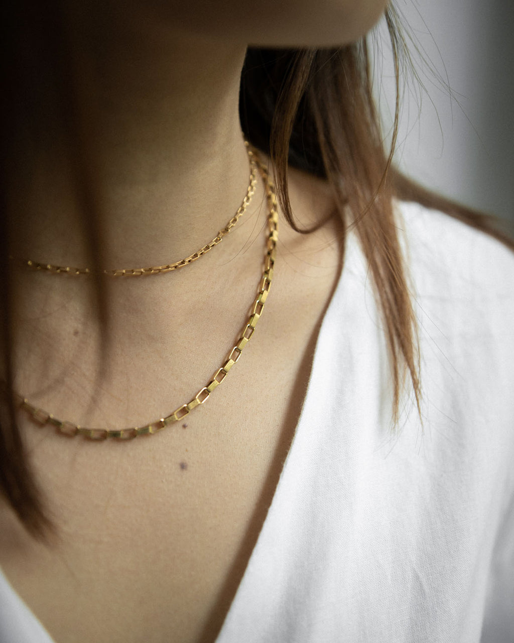 Versatile gold chains featuring interlocking rectangular links with a vintage gold finish - The Hexad Jewelry