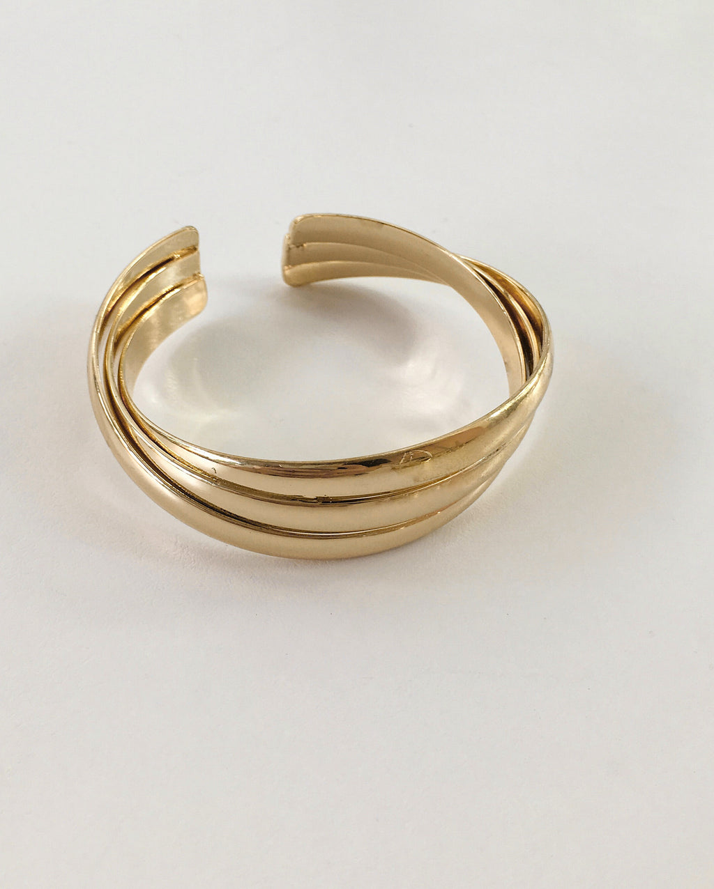 Vintage looking overlapping stacked bangle in gold - TheHexad