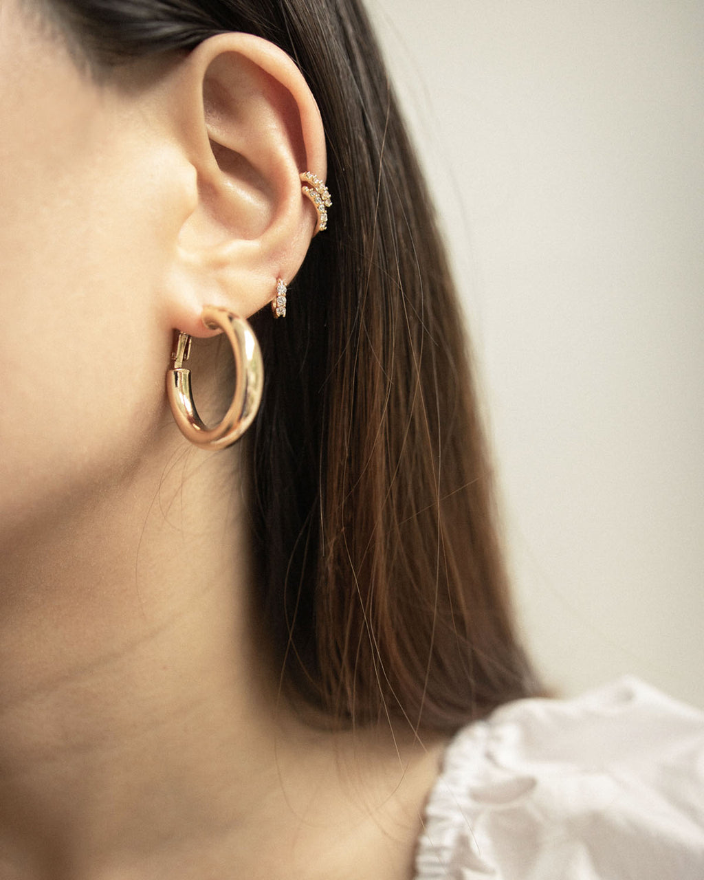 Wearing golden hoop earrings of multiple sizes on same ear - The Hexad